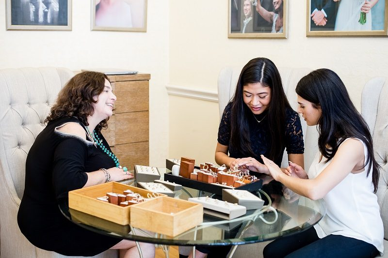 Loyal customers shopping for engagements rings who are decisive and confident in their financially responsible purchase in Los Angeles, California